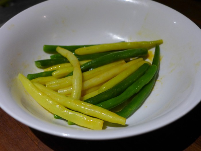 sriracha and sesame oil beans with vegan butter