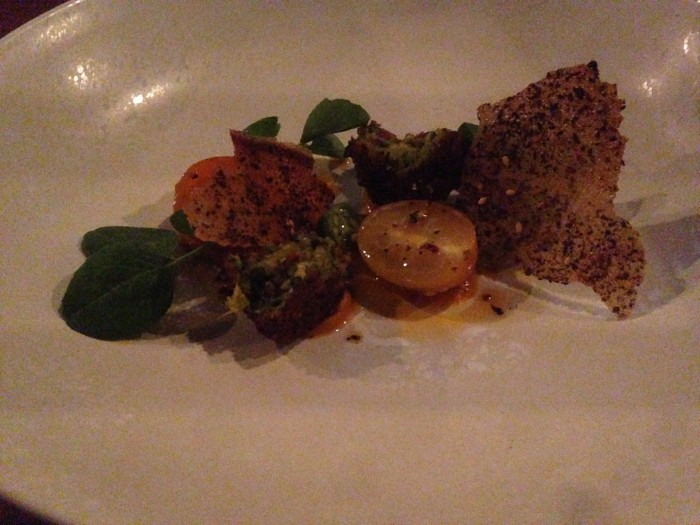 zucchini falafel with tomato, pumpkin puree and zataar and sesame bread