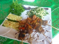 vegetable satay, steamed tofu and tempeh in banana leaf and bean and coconut salad