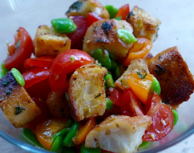 a salad of broad beans, tomatoes and garlic croutons