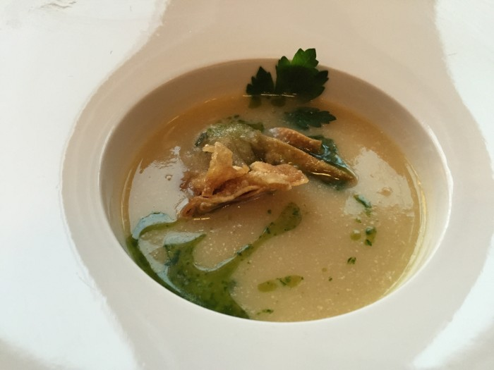 Asparagus soup with a potato wonton and parsley oil