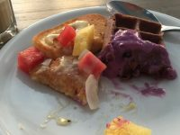 Pancakes with fruit and custard, chocolate waffle with berry yoghurt