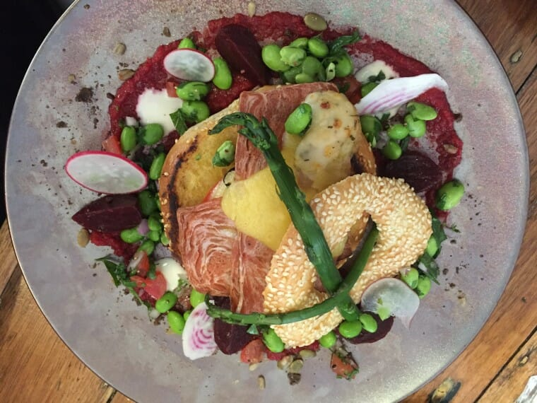 bagel, bacon, cheese, beetroot hummus, broadbeans, radishes, asparagus